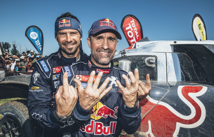 Stephane Peterhansel (FRA) and Cyril Despres (FRA) from Team Peugeot Total at the finish line of stage 13 of Rally Dakar 2016 from Villa Carlos Paz to Rosario, Argentina on January 16, 2016.